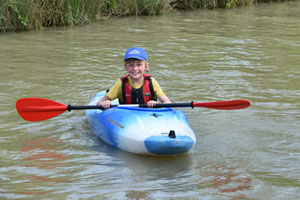 1st Stratford Scout in canoe