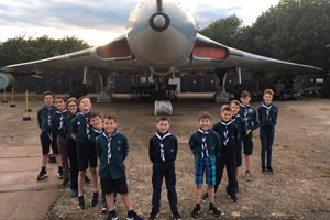 Shottery Scouts stand in front of a large aeroplane at airfield